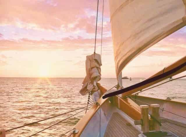 sun setting while aboard a key west sailing charter