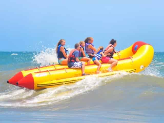 people on a banana boat ride