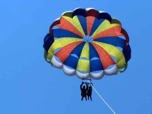 person parasailing over ocean