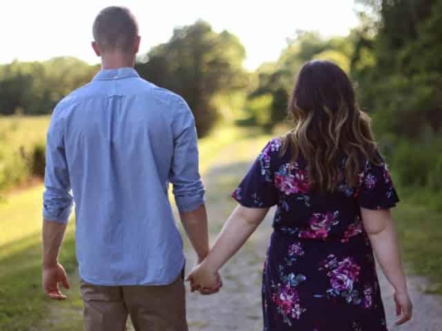 couple walking through a Pensacola park
