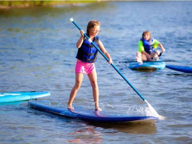 santa rosa beach kids paddleboarding in watersports camp
