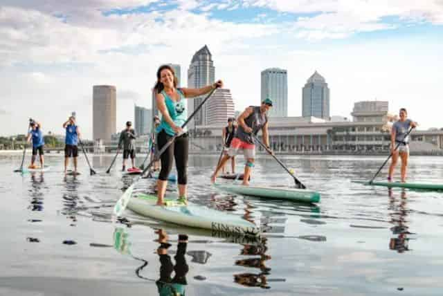 group paddleboarding through downtown tampa