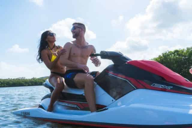 couple riding jet skis in tampa bay fl