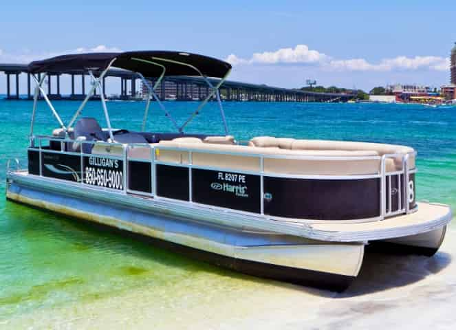 pontoon rental in destin parked at the beach in the harbor