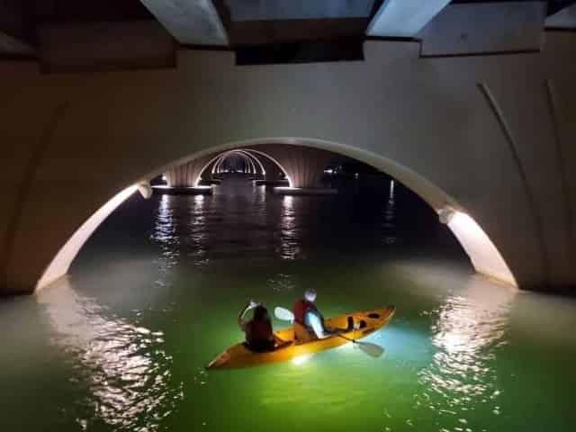 couple enjoys an illuminated kayak tour in Clearwater, FL