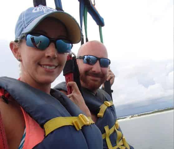 couple on destin parasail tour