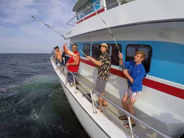 group fishes aboard a party boat in destin