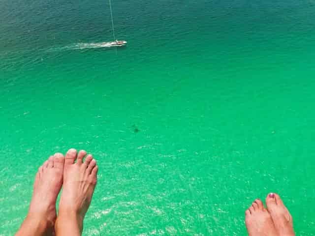 destin parasailing over emerald waters
