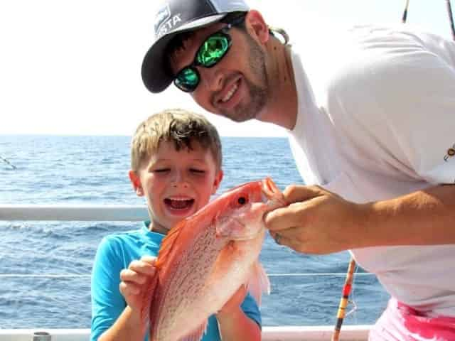 family fishing aboard a party boat fishing charter