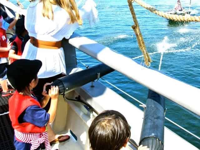 shooting water cannons on a kids pirate cruise