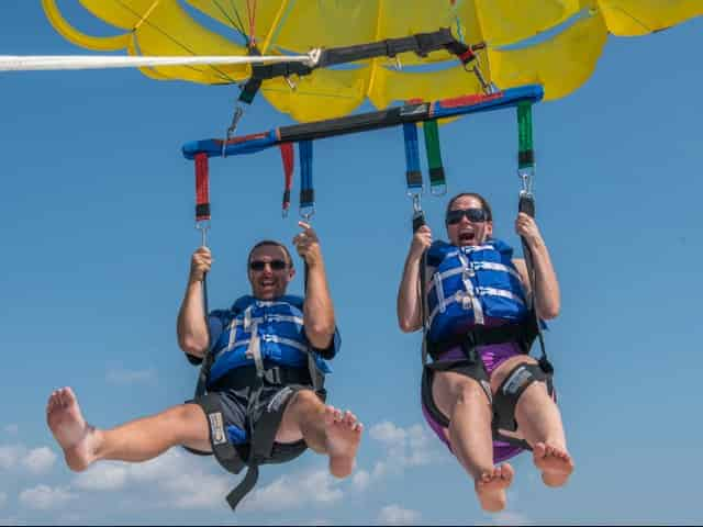 couple parasailing in key west florida