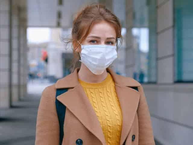 woman in face mask taking precautions against coronavirus