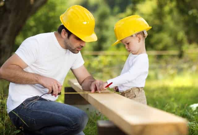 father and son building something together