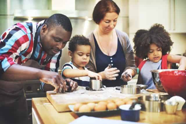family cooking with kids during staycation