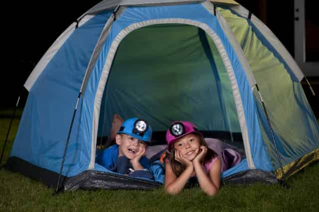 children camping overnight in the backyard