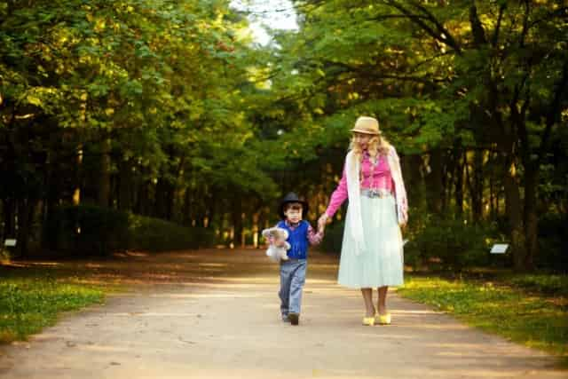 mother walking with child at the park