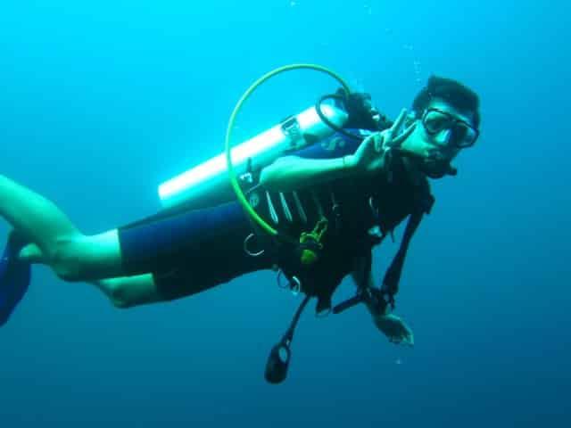 man scuba diving in key west