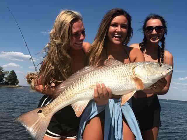 massive redfish caught aboard an inshore fishing charter