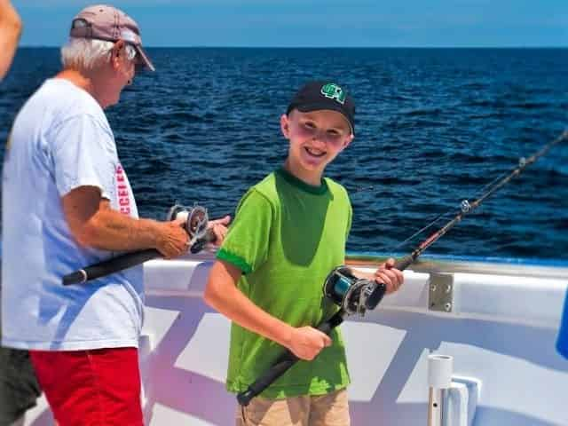 Young angler fishing aboard the Vera Marie in Destin