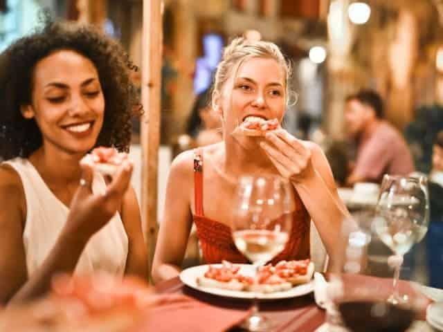 friends dining at murrells inlet boardwalk