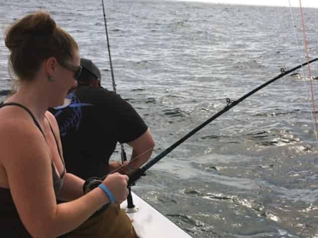 woman offshore fishing with little river fleet