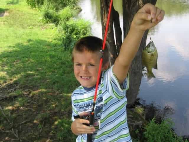 boy proudly shows off catch