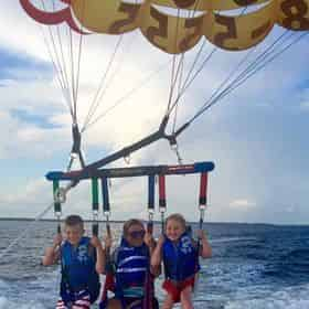 A Dip with the Dolphins Morning Parasailing in Miramar Beach