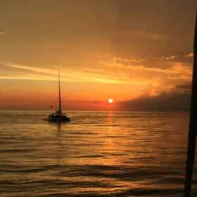 Sunset Dolphin Sail Aboard The Privateer Catamaran